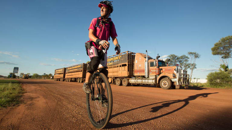 Actor come Transcontinental Unicyclist Samuel Johnson at Daly Waters, 600 km south of Darwin on his round Australia Unicycle Ride inspired by his sisters battle with breast cancer.