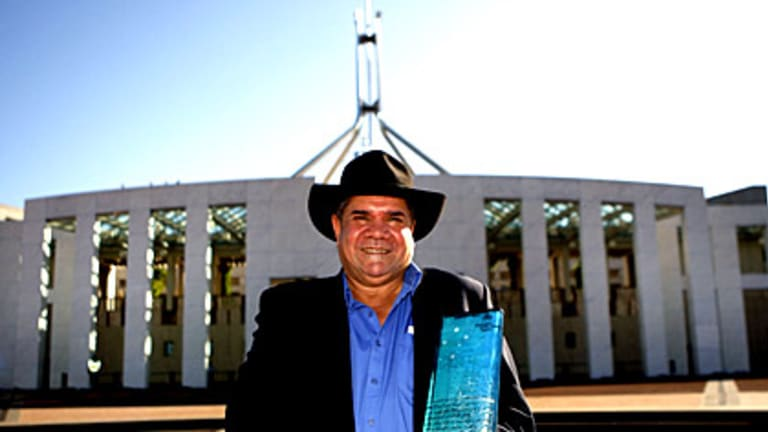 Mick Dodson with his award outside Parliament House.