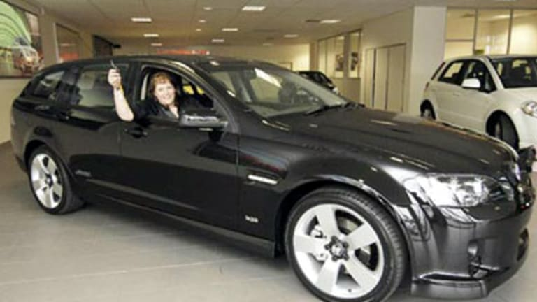 Sonya Causer sits proudly in the Holden SportWagon she successfully bid for in the Royal Children's Hospital Good Friday Appeal Online Auction last year.