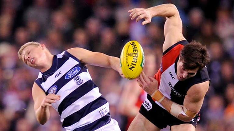 Down for the count: Geelong's Taylor Hunt collides with St Kilda's Lenny Hayes, sending them both sprawling at Etihad Stadium.