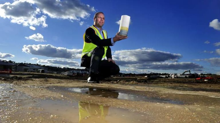 Mark Attiwill holds a micro filtration membrane at  Googong, where a $90 million water recycling project is planned.