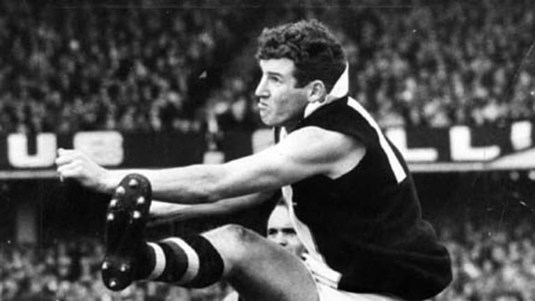 Kevin Neale kicks one of his five goals in the 1966 grand final.