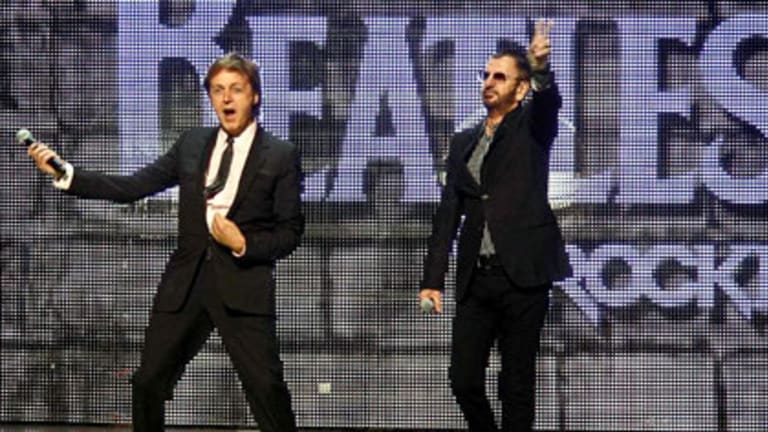 Paul McCartney and Ringo Starr at the launch of <i>The Beatles: Rock Band</i> game in June.
