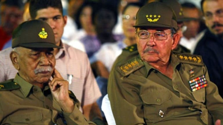 Cuba's Vice President  Juan Almeida Bosque (left) with President Raul Castro at the 50th anniversary of the Cuban revolution. Almeida, one of the original leaders of the Cuban revolution, has died of heart failure at the age of 82.