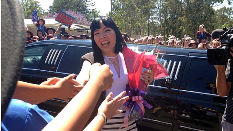 X Factor star Dami Im greets students at her former school.