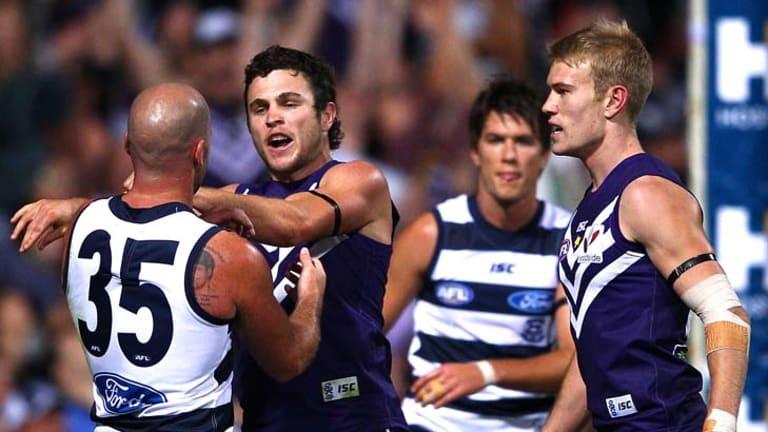 Docker Hayden Ballantyne and Geelong's Paul Chapman clash during Saturday's fiery clash.