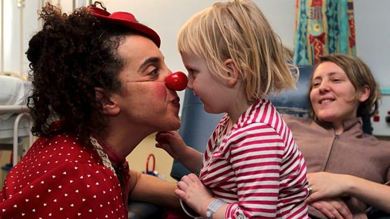 The best medicine ... clown doctor Avital Dvory entertains Freyja Marchand.