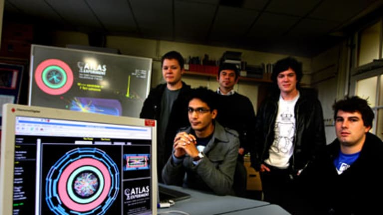 Smashing time ... from left, Ian Watson, Nik Patel, Dr Aldo Saavedra, Mark Scarcella and Cameron Cuthbert, physicists at the University of Sydney who are working on particle collisions from the Large Hadron Collider.