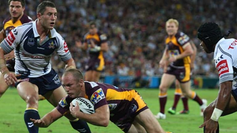 Darren Lockyer dives in for a try for the Broncos in their NRL season opener.