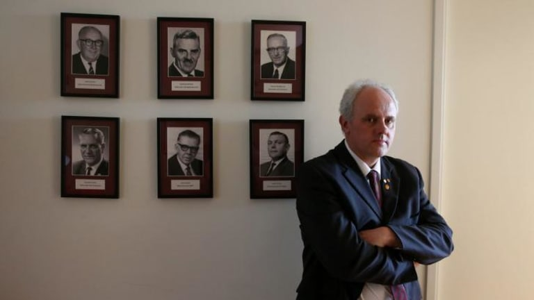 Democratic Labour Party MP no more: Senator John Madigan with portraits of former DLP politicians in his office after announcing he was quitting the party and will continue his term as an independent.