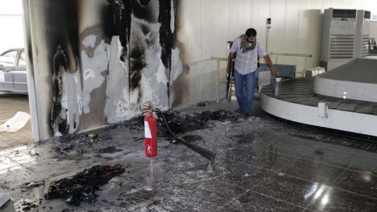 Failing state: a Libyan inspects the baggage carousel area at Tripoli International Airport on Thursday, after militias shelled the facility, destroying planes and parts of the terminal.