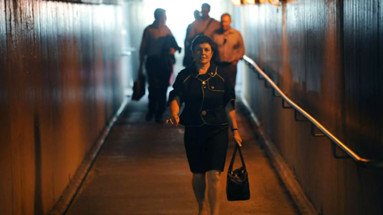 Public Transport Minister Lynne Kosky walks through an underpass to catch a train after the bridge opening ceremony.