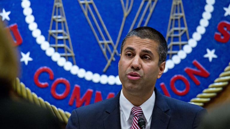 Ajit Pai, chairman of the Federal Communications Commission, speaks during an open commission meeting in Washington, DC.