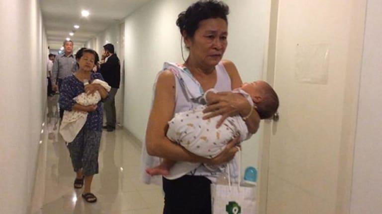 Officials conduct a raid on the condominium in Bangkok.