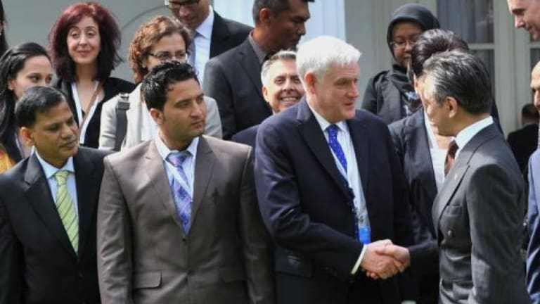 Critical of Australia's tow-back policy ... James Lynch (front, third from left), Regional Representative of the UNHCR for South East Asia Region shakes hands with Indonesian Foreign Minister Marty Natalegawa.
