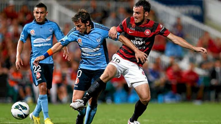 No quarter: Alessandro Del Piero of Sydney FC tangles with ex-Sydney man Mark Bridge in a derby last year.