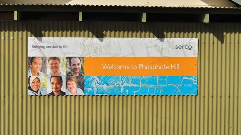 A welcome sign by management company SERCO adorns the side of a building at Phosphate Hill Detention Centre in Christmas Island.