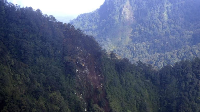 Crashed ... In this photo released by Indonesian Air Force, the wreckage of a missing Sukhoi Superjet-100 are scattered on the mountainside in Bogor, West Java, Indonesia.