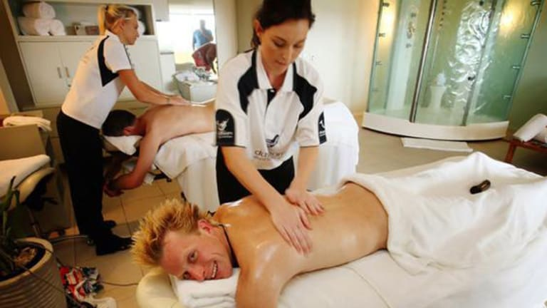 """The Best Job in the World"" competition winner Ben Southall of Britain receives a massage on Daydream Island."