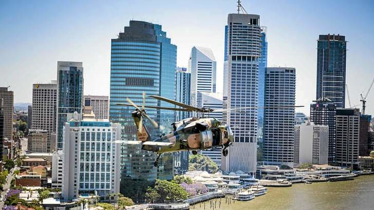 Blackhawk helicopters fly over Brisbane in an exercise ahead of the G20.