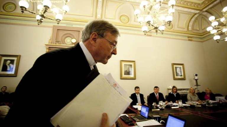 There should be no forgetting the substantial and long-term costs of child abuse for the health system. Cardinal George Pell (pictured) before the Parliamentary enquiry into child sex abuse.