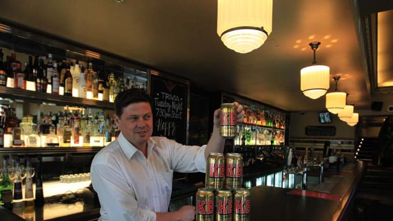 Striking gold ... publican Brenden Lawless with his last remaining cans of KB Lager. ''I was begging the man from CUB, 'Please don't cut us off.' ""