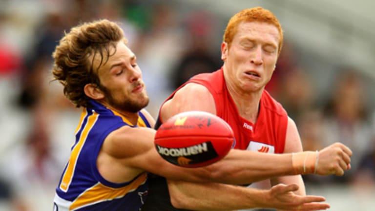 West Coast's Will Schofield spoils Melbourne midfielder Matthew Bate.