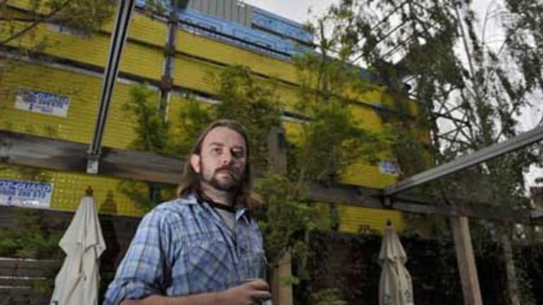 Justin Rudge, Band booker at the Standard Hotel in Fitzroy in the beer garden, with new flats going up next door.