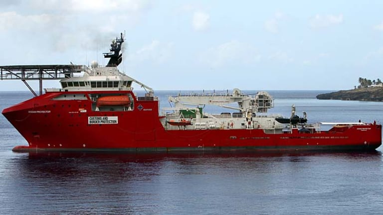On standby: The Australian Customs and Border Protection vessel Ocean Protector.