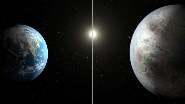 An artist's impression of a comparison between the Earth, left, and the planet Kepler-452b.