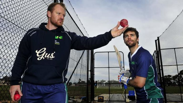 Simon Cusden and Ryan Carters, right, during a cricket coaching course at Harrison Oval.