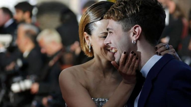 Director Xavier Dolan, Jury Prize award winner for his film 'Mommy', and actress Suzanne Clement pose on the red carpet.