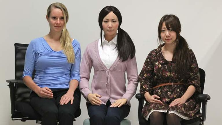 Kerstin Haring, PHD student from Reasearch Centre for Advanced Science and Technology, Tokyo , android- Actroid-F, and Kaori Tanaka a graduate student at University os Tsukuba.