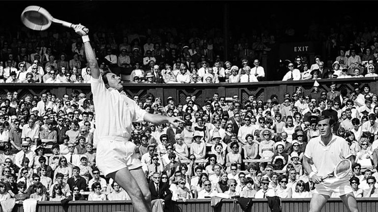 Ken Fletcher (left) and John Newcombe compete in the 1966 Wimbledon final.