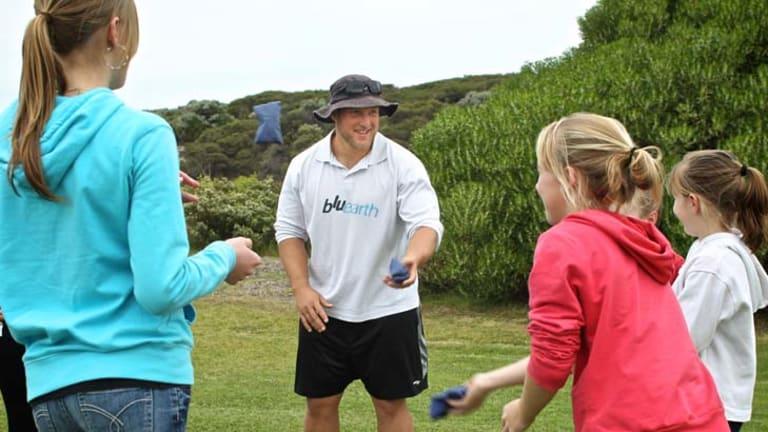 Dale Stevenson, Bluearth Coach and Commonwealth Games bronze medallist, doing PE with schoolchildren.
