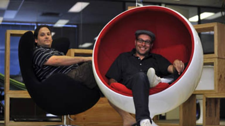 Brothers Hezi and Gabby Liebovich (hat), owners of Australias largest online store in their modern office with groovy furniture.