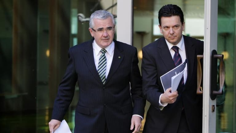 Independent MP Andrew Wilkie, left, and independent Senator Nick Xenophon. Mr Wilkie has threatened to vote against the government's poker machine reform bill because he says they are too weak.
