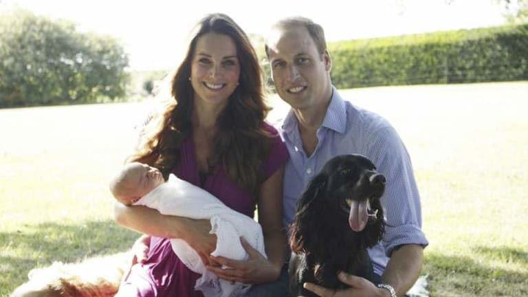 Happy family: William and Catherine with baby George in the first official photos of the new prince.