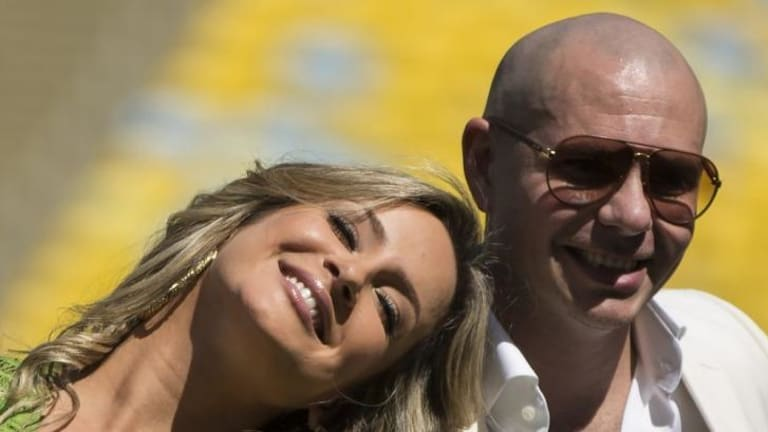 Claudia Leitte and Pitbull perform the World Cup song with Jennifer Lopez.