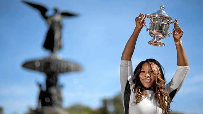Serena Williams poses with her US Open trophy in Central Park.