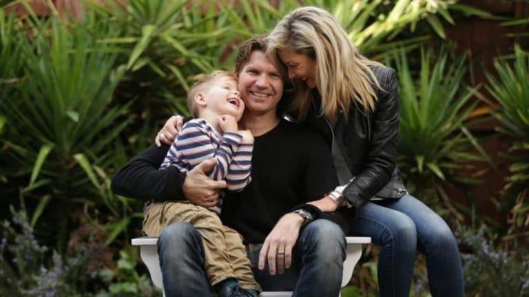 Simon Meredith with wife Leiza and son Hamish.