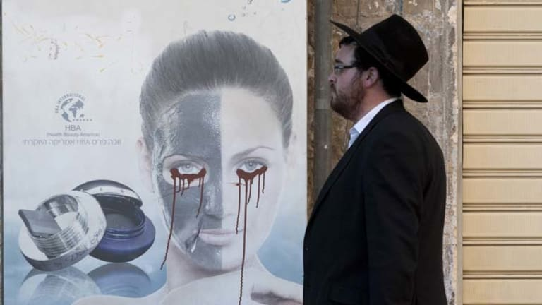 The face of extremism ... across Jerusalem posters featuring women have been defaced by ultra-Orthodox Haredim.