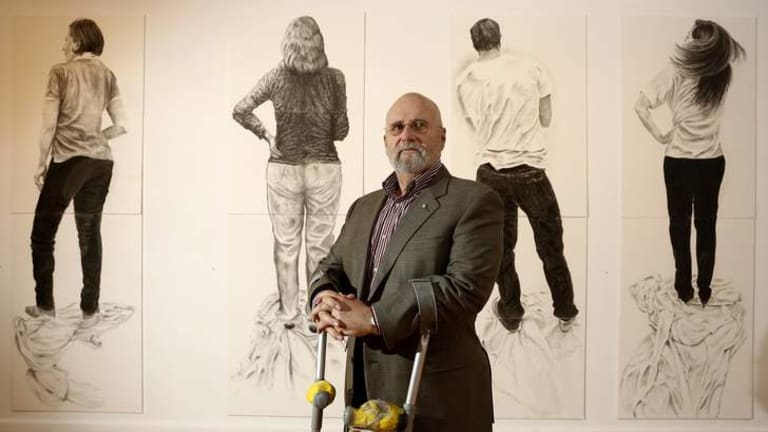 Artist Roger Beale in front of his work 'The Family'.