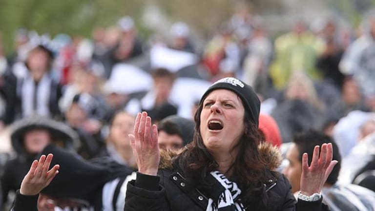 Pies' pain: The Magpie Army braved rain and mud to cheer on their beloved Collingwood from Gosch's Paddock, but the result went against them.