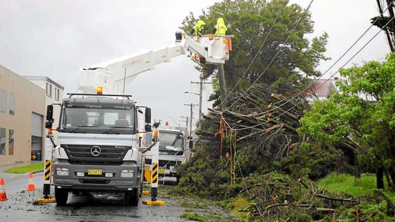 The clean-up under way in Kempsey.