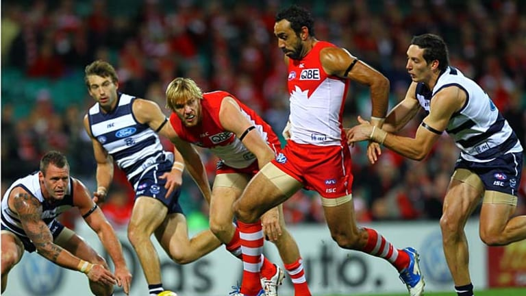 Best foot forward: Sydney star Adam Goodes attempts to kick the ball against Geelong last night.