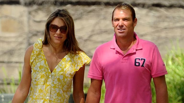 Furious ... Shane Warne, with fiancee Liz Hurley, in Melbourne on January 5.
