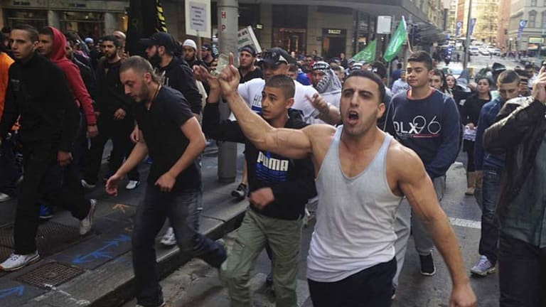 Protesters on the streets of Sydney on their way to the US consulate today.