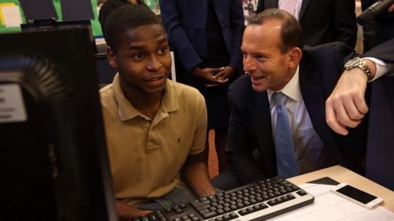 Prime Minister Tony Abbott, right, visited the Pathways in Technology Early College High School in Brooklyn, New York.