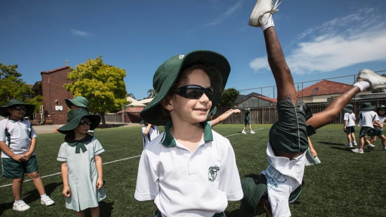 Our Lady of Fatima school introduced sunglasses, worn here by Alexia Challita, 6, as an optional part of the school uniform.